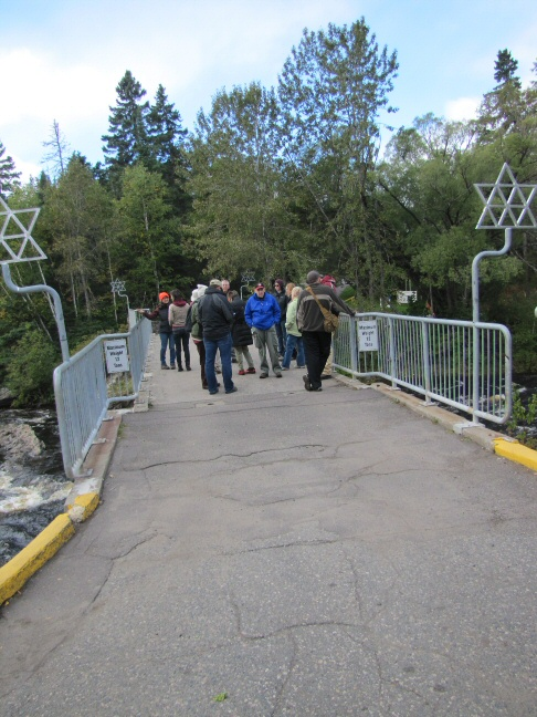 The trek begins on a bridge over rushing waters