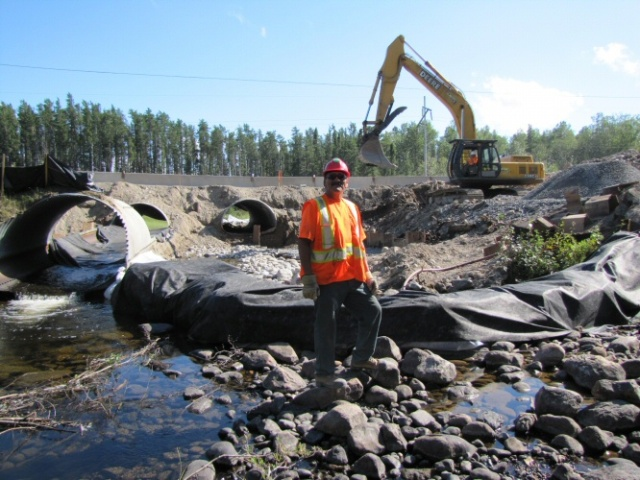 Darren Bananish stands downstream of the culverts being replaced.