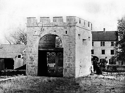 This 1885 photo shows Government House behind the Gate.