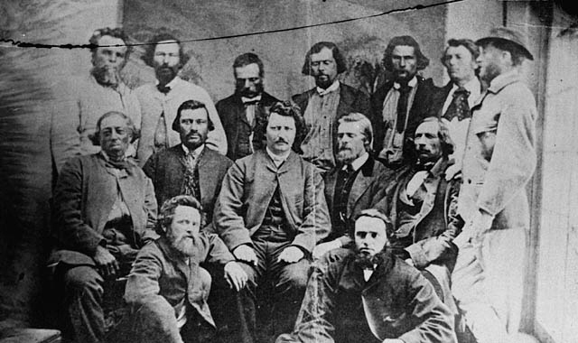 Louis Riel in a happy place, surrounded by members of the Provisional Government.