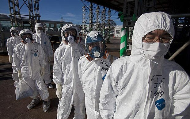 To this day, workers in protective gear are cleaning up the Fukushima plant. -Google image