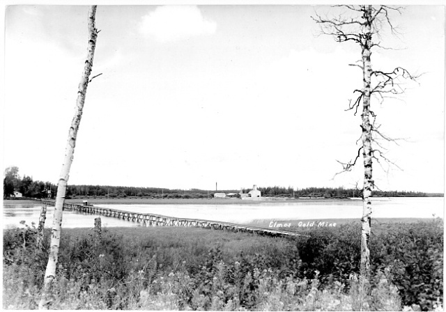 Bridge or trestle connecting mainland with large island in 1938-9. Main building cluster is on central island, from which a trestle would later run to the mainland.
