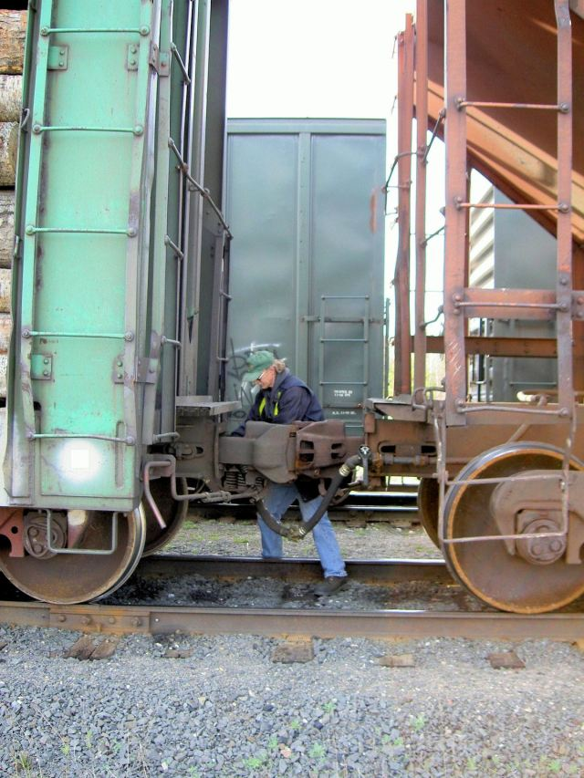 Brakeman Hughson coupling cars at Jellicoe.