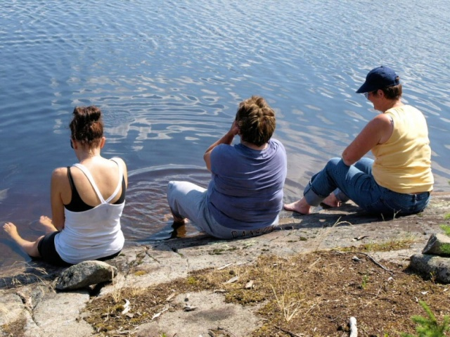 Hikers soak their feet in Browse Lake.