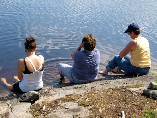 Hikers soak their feet in Browse Lake.