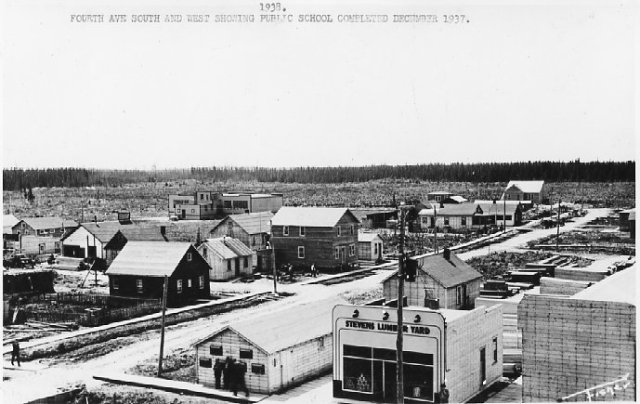 In 1938, the one-storey public school stands in a clearing on the edge of town.  Looking southwest from Main Street.  Greenstone Historical Society photo.